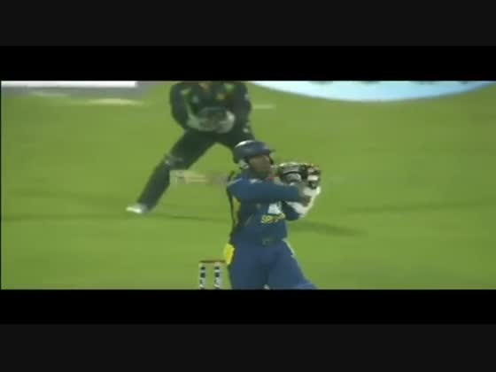 Muralitharan takes a one handed return catch at full stretch